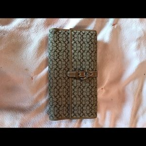 Coach Signature Trifold wallet brown and tan.